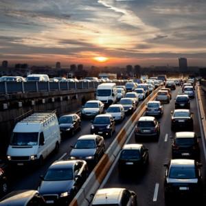 Late afternoon traffic. Traffic jam. Cars. Urban scene.